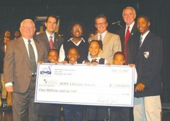 Ron Jones (left), president of the Siebert Lutheran Foundation, presents a check for million to HOPE Christian Schools. Students celebrate with County Executive Scott Walker, HOPE Superintendent Kole Knueppel, and Mayor Tom Barrett.