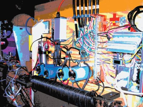 Transformers and capacitors mold the pedal power into fluid electrons to amplify the music.